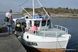 Sal av fisk direkte frå fiskebåt ved kaien